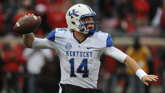 Kentucky quarterback Patrick Towles looks to pass against Louisville on Saturday at Papa John's Cardinal Stadium. (By David Lee Hartlage, Special to the C-J) Nov. 29, 2014.