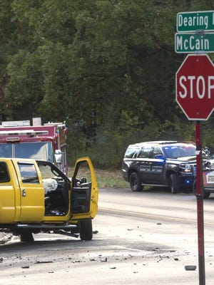 Police and emergency personnel respond to the scene of a crash in Jackson.