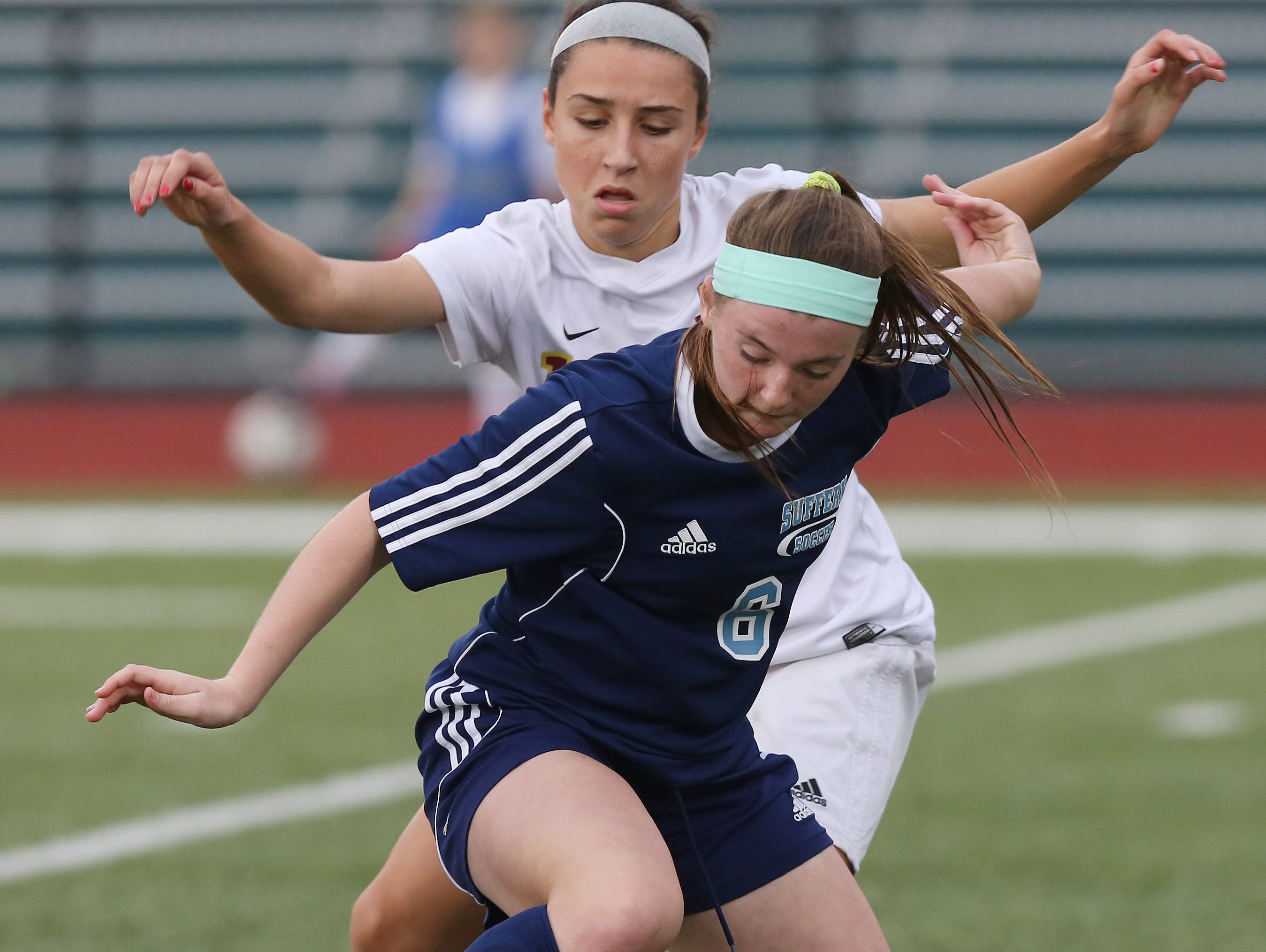 Suffern's Caitlin Hirsch (6) and Arlington's Allie Coon battle for ball control during the girls soccer Section 1 Class AA championship game at Yorktown High School Oct. 30, 2016. Arlington won the game 2-0.
