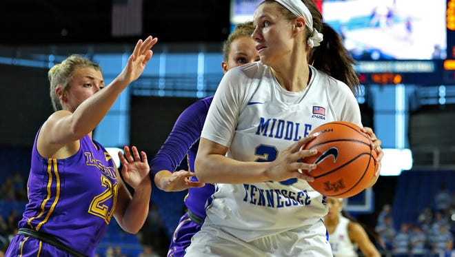 MTSU forward Gabby Lyon is defended by two Lipscomb players during their game at Murphy Center on Nov. 19, 2017.