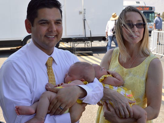 Rep. Raul Ruiz and his wife, Monica, hold their 3-month-old