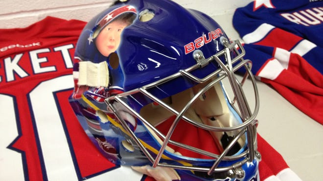 Matt Hackett's cousins adorn his new mask.