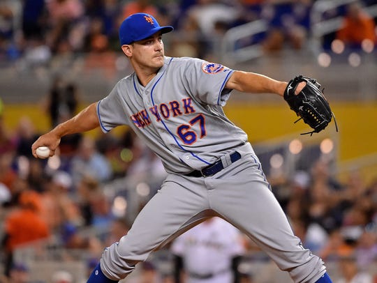 Mets starter pitcher Seth Lugo (67) got the win after