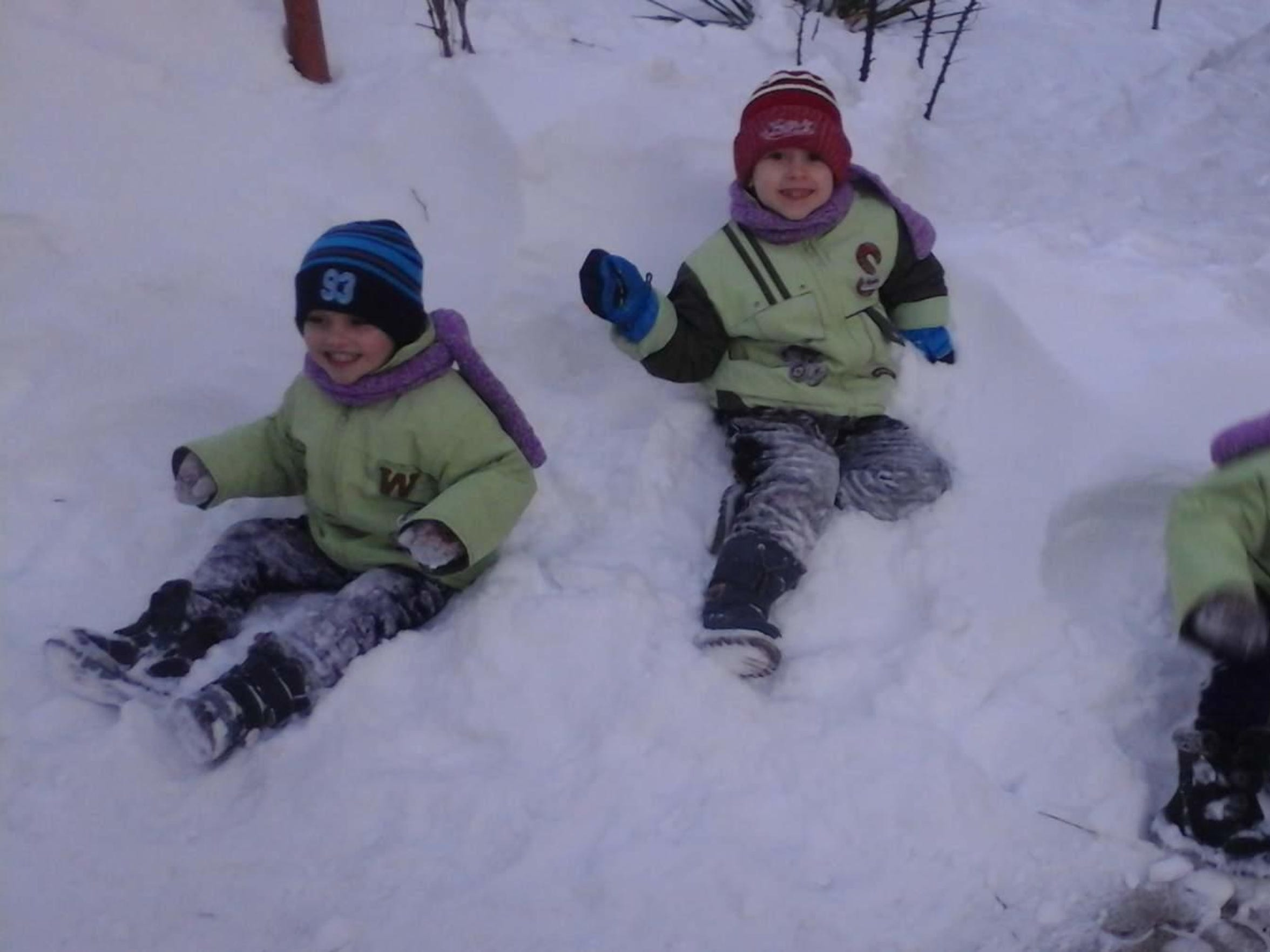 The Malac children play in the snow in Moldova last winter.