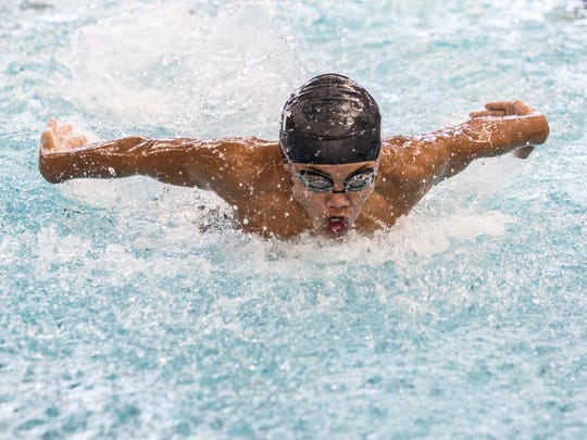 Noah Fuller, swimming for the Johnstown-Northridge Jaguars swims the butterfly stroke in the medley relay at the Tri-County Aquatic League Championship swim meet at Denison University.