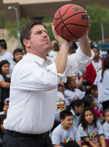 Phoenix Mayor Greg Stanton shoots baskets with students from Lowell Elementary School during the 2017 NCAA Men's Basketball Final Four logo unveiling and announcement of plans for an NCAA Legacy Restorations project at Harmon Park in Phoenix November 10, 2015.