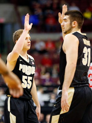 Jan 5, 2017; Columbus, OH, USA;  Purdue Boilermakers guard Spike Albrecht (55) is congratulated by Boilermakers guard Dakota Mathias (31) after his three point basket during the first half against the Ohio State Buckeyes at Value City Arena. Mandatory Credit: Joe Maiorana-USA TODAY Sports