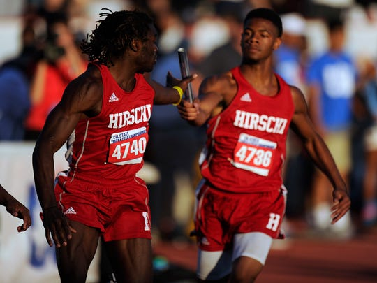 Hirschi's Gerrick McKinney (4740) grabs the baton from teammate Javen Banks on the third leg of the Class 4A boys 800m relay during the UIL State Track and Field Championships on Saturday, May 13, 2017, at Mike A. Myers Stadium in Austin.