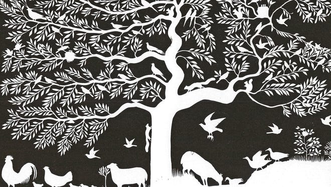 This paper-cutting of trees, birds and animals is typical of Seymour Lindsey's work.