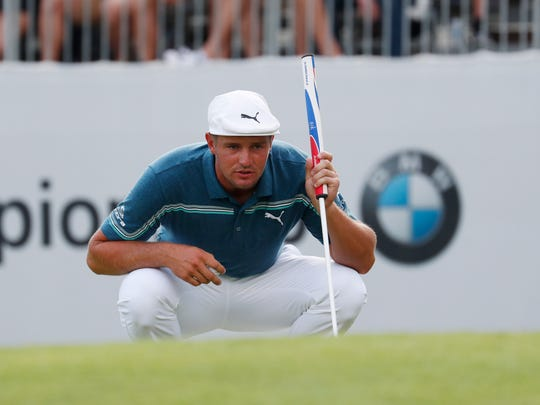 Bryson DeChambeau lines up a putt on the 18th hole Aug. 16 during the second round of the BMW Championship golf tournament at Medinah Country Club.