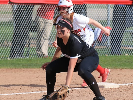Getting set at third base during a 2014 contest is Plymouth's Brittney Miller. She brings excellent defense and a power bat to the Wildcats' lineup.