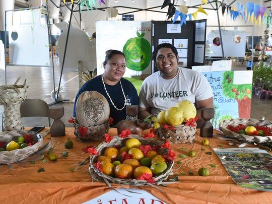 F.B. Leon Guerrero Middle School teachers Camalin Perez, left, and Leonard-John Ventura, right,  smile for the camera during the 1st Annual Yigo Citrus Festival 2016 at the Yigo Gym on June 4.