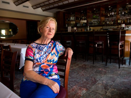 Maria Furetta, owner of Bellini on Fifth Italian Ristorante, poses for a portrait in her restaurant on Monday, Aug. 7, 2017. The city's proposed parking garage would be built in the parking lot on the corner of Fourth Avenue South and Fourth Street South in Naples, Florida. Business owners on Fifth Avenue say they support the city's proposal for the $15 million project because it will free up parking in the area and direct visitors to the west end of the street.