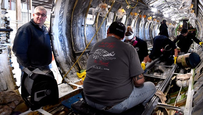 David Young, Abilene ISD superintendent, looks inside a stripped-down airplane at Eagle Aviation Feb. 9. Members of Team Workforce are working to ensure vocational technology programs are meeting the needs of Abilene employers.