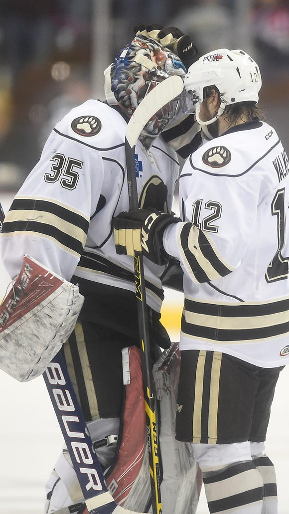 Bears goalie Justin Peters (35) and Nathan Walker (12) celebrate their 2-1 win over the Portland Pirates on Sunday at Giant Center that clinched the Atlantic Division Semifinal series.
