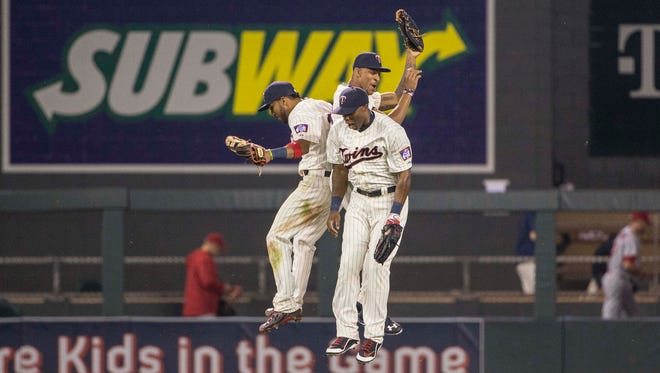 Eddie Rosario, Byron Buxton and Torii Hunter celebrate a recent  victory.