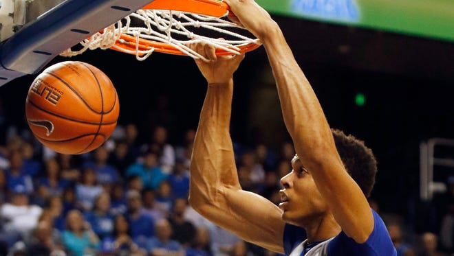 The White Squad's Skal Labissiere dunks during a Kentucky NCAA college basketball scrimmage, Tuesday, Oct. 27, 2015, in Lexington, Ky. (AP Photo/James Crisp)
