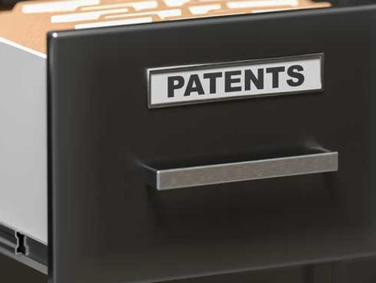 Drawer in a filing cabinet labeled patents.