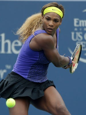 Serena Williams eyes a backhand against Ana Ivanovic, from Serbia, during a final match at the Western & Southern Open tennis tournament, Sunday, Aug. 17, 2014, in Mason, Ohio. (AP Photo/Al Behrman)