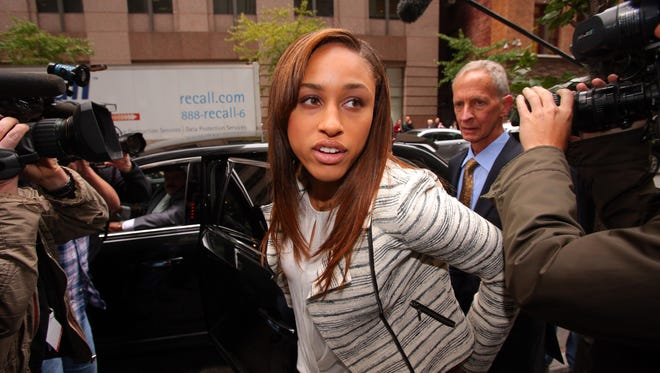 Janay Rice, wife of suspended NFL running back Ray Rice (not pictured) exits a car in front of Ray Rice attorney Peter Ginsberg (right) to enter the building where Rice will appeal his indefinite NFL suspension.