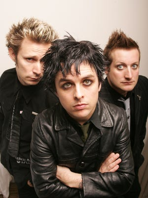 Green Day  (left to right) bass player Mike Dirnt, vocals and guitar Billie Joe Armstrong, and drummer Tre Cool.