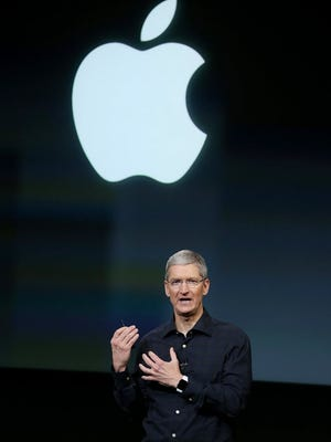 Apple CEO Tim Cook speaks during an Apple special event on Oct. 16, 2014, in Cupertino, Calif.