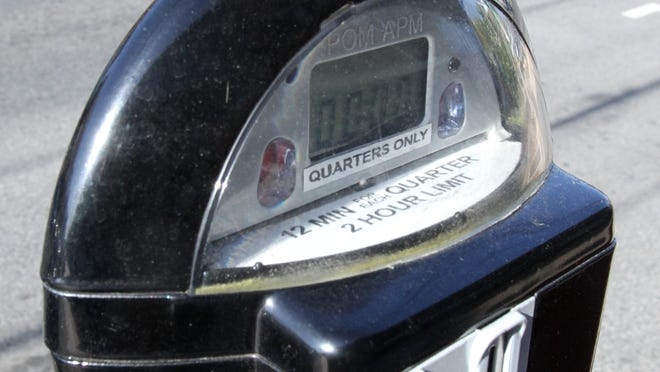 Wilmington will not require drivers to feed on-street parking meters after noon daily through Dec. 31