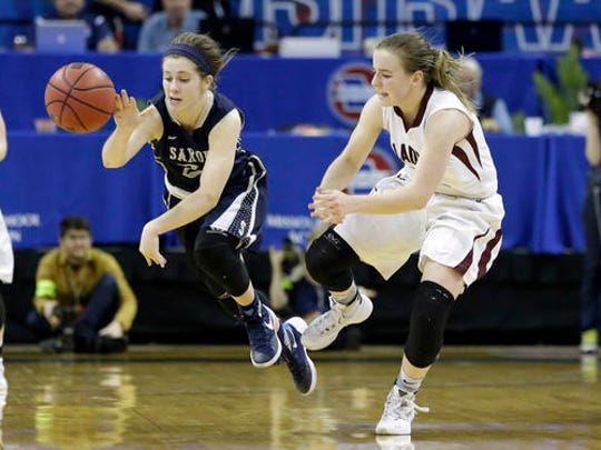 Saxony's Raegan Wieser, left, loses control of the ball after colliding with Strafford's Abby Oliver during the second half of the Missouri Class 3 girls high school championship basketball game Saturday, March 12, 2016, in Columbia, Mo. Strafford won 50-46. (AP Photo/Jeff Roberson)