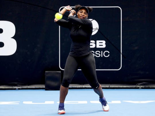 United States' Serena Williams hits a ball during a practice session at the ASB Classic tennis tournament in Auckland, New Zealand, Friday, Dec. 30, 2016. Williams has announced her engagement to Reddit co-founder Alexis Ohanian. The tennis great posted a poem on the social news website that she accepted his proposal.