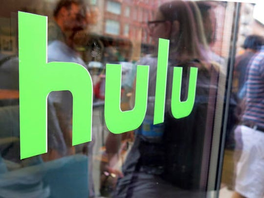 FILE - This June 27, 2015, file photo, shows the Hulu logo on a window at the Milk Studios space in New York.