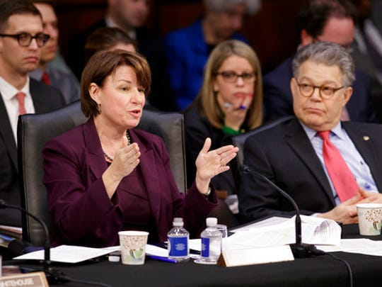 Democratic members of the Senate Judiciary Committee, Sen. Amy Klobuchar, D-Minn., left, and Sen. Al Franken, D-Minn., question the Republican side as the panel meets to advance the nomination of President Donald Trump's Supreme Court nominee Neil Gorsuch, Monday, April 3, 2017, on Capitol Hill in Washington.
