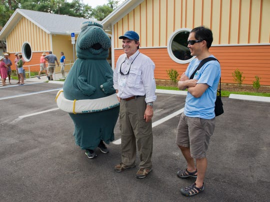 Pelican Island Audubon Society board member, Bill Loftus (center) waits with Andy Liu (right) and Liu's son, Erik, 15, (in the manatee costume) at the new Audubon House on Olso Road in Vero Beach in 2015.