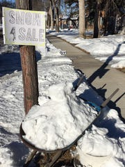 "A real deal: ""Snow 4 Sale on the 30 block of 2nd Avenue"