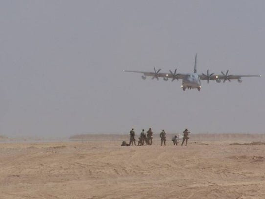 A C-130 cargo plane from the 120th Airlift Wing of