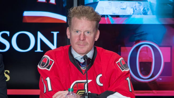 Dec 4, 2014; Daniel Alfredsson speaks to the media after signing a one day contract to return to the Ottawa Senators during a press conference at Canadian Tire Centre where he announced that he would be retiring.