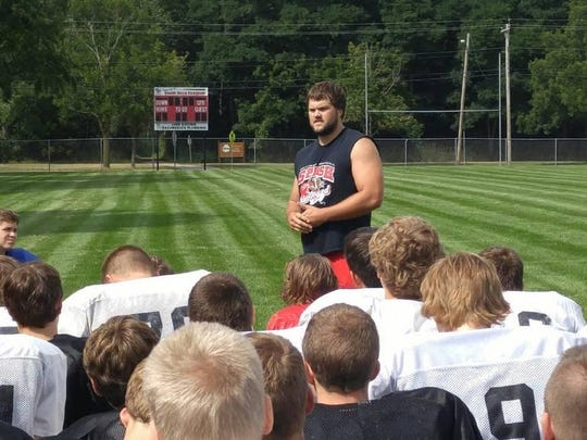 Former SPASH athlete Ryan Ramczyk, who has transferred to the University of Wisconsin after two standout seasons at UW-Stevens Point, addresses the Panthers football team during a recent practice.
