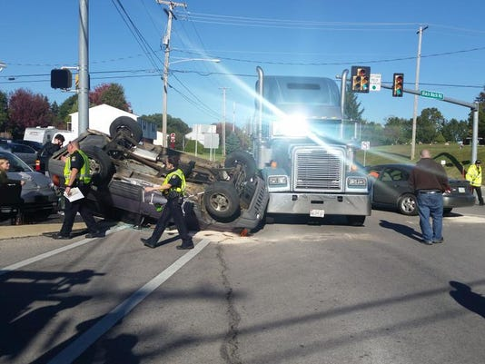 An SUV is overturned at Black Rock and Grandview roads in Penn Township on Monday.