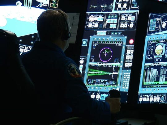 NASA astronaut Eric Boe uses the Crew Part-Task Trainer, a touch-screen simulator, during a training session at The Boeing Company's Defense, Space & Security division in St. Louis, Tuesday, April 26, 2016. Boeing is one of two private U.S. companies contracted by NASA to transport astronauts from Cape Canaveral, Florida, to the International Space Station. Its spacecraft, the CST-100 Starliner, is expected to have its first test flight to the space station by the end of 2017. (AP Photo/Alex Sanz)