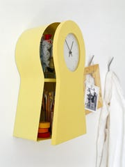 The IKEA PS 1995 Clock in yellow comes with the added perk of storage for smaller items inside.