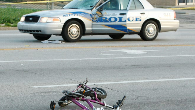 Metro police are investigating the accident.  The officer is on paid administrative leave.  (by David Harpe, Special to the Courier-Journal)  May 4, 2008.