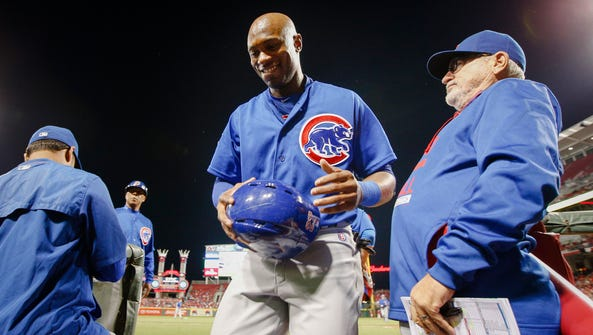 Chicago Cubs outfielder Austin Jackson, center, smiles