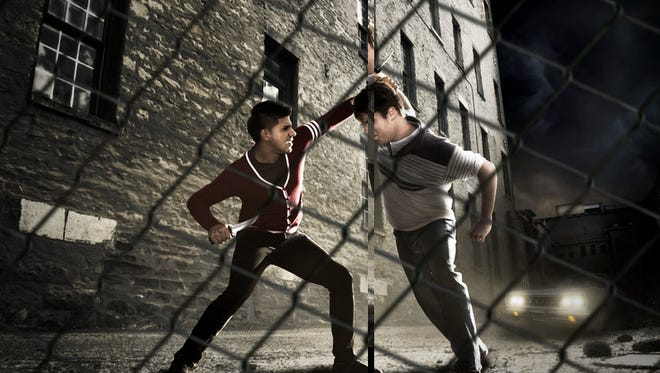 Raul Torres plays Bernardo, and Alec Powell plays Riff, in West Side Story at Kodak Center for the Performing Arts.