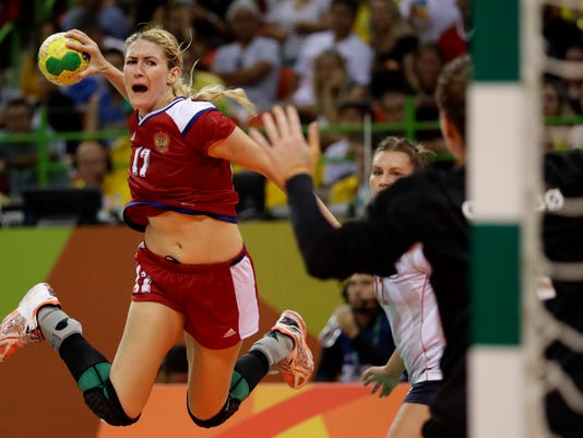 Russia's Vladlena Bobrovnikova scores a goal during the women's semifinal handball match between Norway and Russia at the 2016 Summer Olympics in Rio de Janeiro, Brazil, Thursday, Aug. 18, 2016. (AP Photo/Matthias Schrader)