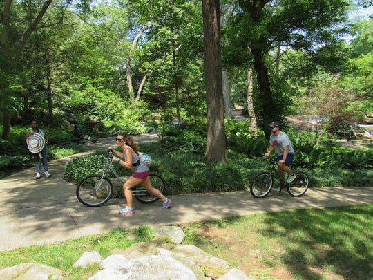 Bikers make their way on the Swamp Rabbit Trail through