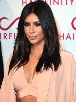 Kim Kardashian attends the Hairfinity U.K. Launch Party on Nov. 8, 2014 in London, England.