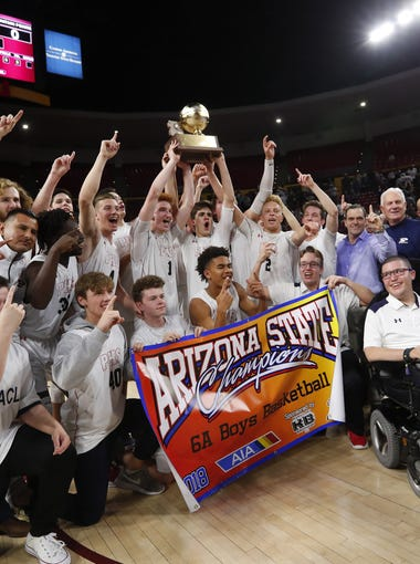Pinnacle players pose for a photo after beating Mountain Pointe in the 6A Boys State Basketball Championship game at Wells Fargo Arena in Tempe, Ariz. February 28, 2018.