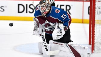 Colorado Avalanche goaltender Andrew Hammond (35) filling in for goaltender Jonathan Bernier (45) plays the puck late in the third period of game 4 in the first round NHL Stanley Cup Playoffs at the Pepsi Center, Wednesday, April 18, 2018, in Denver, Colo.
