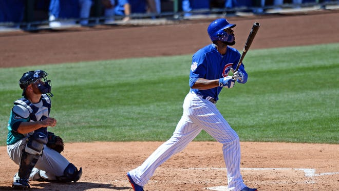 Mar 27, 2016: Chicago Cubs right fielder Jason Heyward (22) hits a two run home run during the third inning against the Seattle Mariners at Sloan Park.