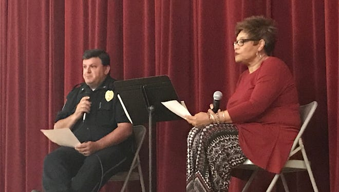 Former Henderson Police Chief Chip Stauffer, left, and Deborah Jackson Hoda, president of the Henderson NAACP, lead a town hall summit on policing issues last year. The Henderson NAACP is hosting another forum this Friday on violence.