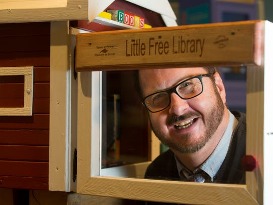 Little Free Library co-founder Todd Bol is shown with the first library he made in Hudson.